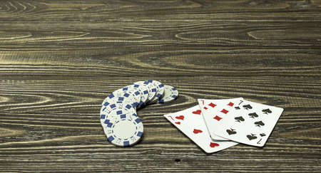 distribution board: Poker chips and playing cards on the table. Focus on cards