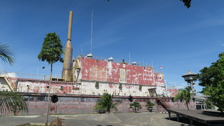 Banda Aceh, Aceh Province, Indonesia - June 19 2017 : PLTD Apung is an electric generator ship. The 2,600 ton vessel had been in the sea and was flung 2 to 3 kilometres inland by the Indian Ocean earthquake and tsunami