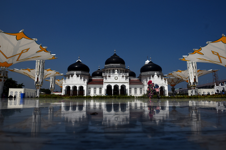 Baiturrahman Grand Mosque is located in Banda Aceh. Baiturrahman is the Great Mosque was built since centuries years ago in Banda Aceh. It is the symbol of religious life, bravery, and nationalism of Aceh people. Editorial