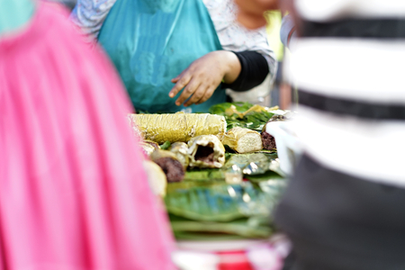 People buying Sticky Rice desserts in street food market during ramadan fasting month at Banda Aceh City, Aceh Province, Indonesia.