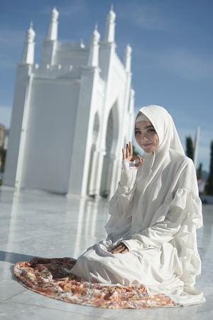 Young asian muslim woman in hijab dress