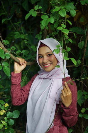 Young Muslim woman in Nature with beautiful smile