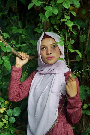 Portrait of the beautiful muslim girl in Nature Stock fotó