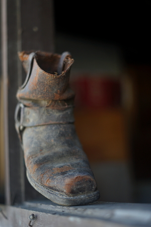 Old dusty vintage boot at abandoned building