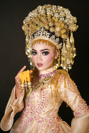 Beautiful bride in Indonesian traditional wedding dress