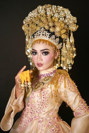 Beautiful bride in Indonesian traditional wedding dress