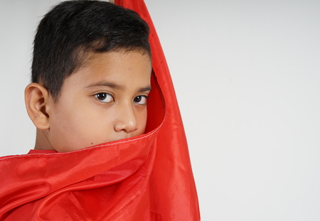 Boy covered with Red Flag (Indonesian Flag) 免版税图像