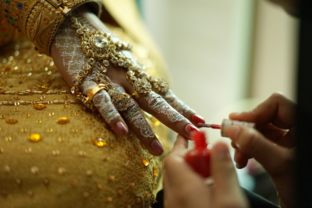 Wedding Ritual, woman hand applying a henna tattoo