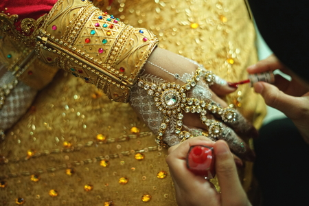 Wedding Ritual, woman hand applying a henna tattoo