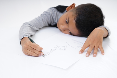 Young boy writing Mothers Day message