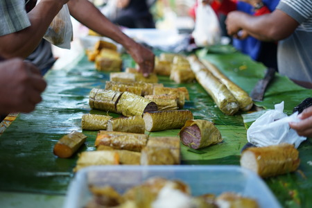 Lemang Bamboo or sticky rice with coconut milk sale at ramadhan street food market in Indonesia Stock Photo