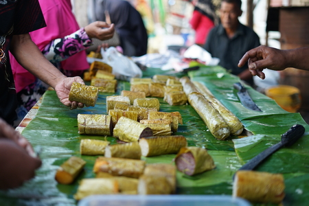 Lemang Bamboo or sticky rice with coconut milk sale at ramadhan street food market in Indonesia Stock Photo - 122471846