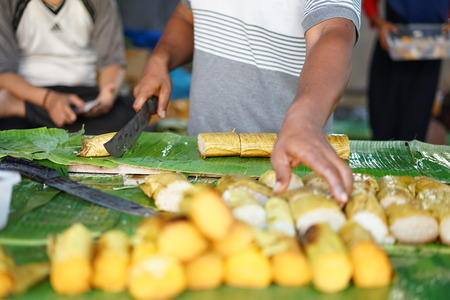 Lemang Bamboo a traditional Asian Foods made of glutinous rice, coconut milk and salt, cooked in a hollowed bamboo stick Stock Photo - 122471852