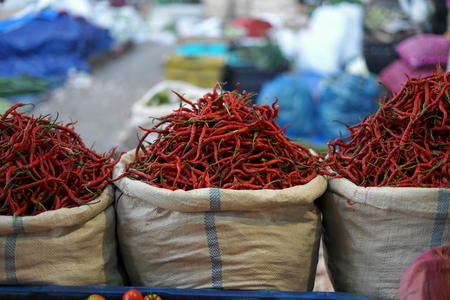 Sack of Red hot chili peppers Sale at Vegetable Market
