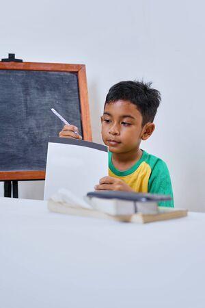 Elementary Schoolboy Struggling in exam