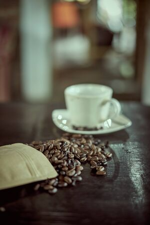 Roasted Arabica coffee beans and Glass of Coffee 写真素材