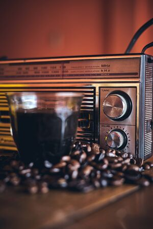 Black Coffee, Coffee beans and stylish vintage portable radio 免版税图像