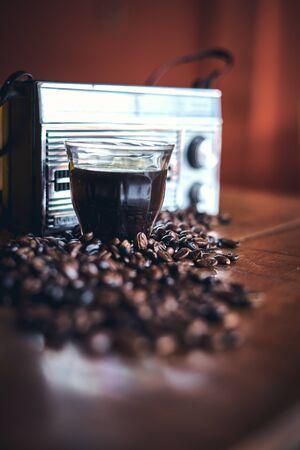 Black Coffee, Coffee beans and stylish vintage portable radio 写真素材