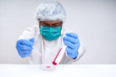 Doctor holding blood sample tube with coronavirus in Indonesia medical and healthcare 版權商用圖片