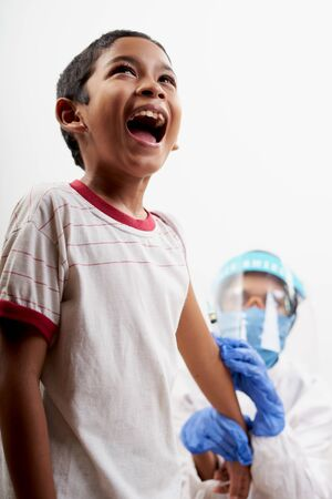 Scared Little boy get vaccination injection. Concept of prevention world coronavirus pandemic
