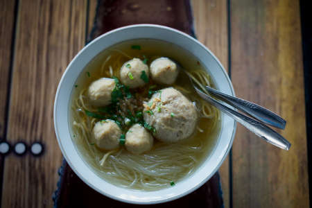 Meatballs with Noodle Soup on table at street food market Stockfoto