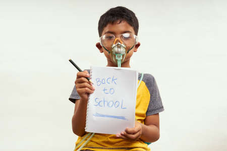 Schoolboy just bored of online classes and wanted Back to school. Home Education concepts