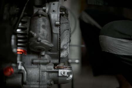 Closeup man hands repairing retro motorcycle