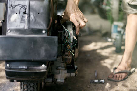 motorcycle mechanic repairing retro motorcycle Stockfoto