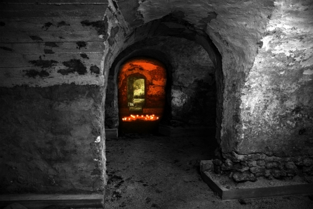 inquisition: Empty abandoned dungeon with red candles light