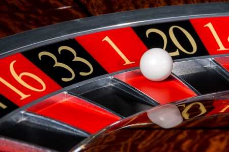 spinning wheel: Classic casino roulette wheel with red sector one 1 and white ball and sectors 16, 33, 20, 14