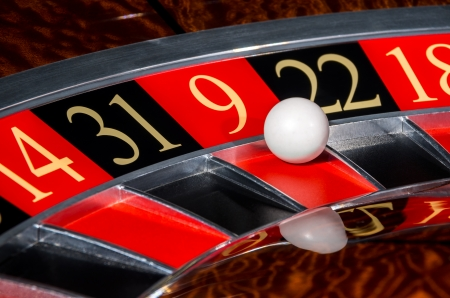 9 ball: Classic casino roulette wheel with red sector nine 9 and white ball and sectors 14, 31, 22, 18