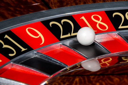 9 ball: Classic casino roulette wheel with black sector twenty-two 22 and white ball and sectors 31, 9, 18, 29