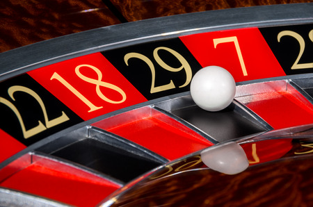 20 29: Classic casino roulette wheel with black sector twenty-nine 29 and white ball and sectors 22, 18, 7, 28 Stock Photo