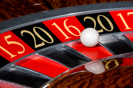 New Year 2016 classic casino roulette wheel with red sector sixteen 16 and white ball and sectors 20, 15, 17
