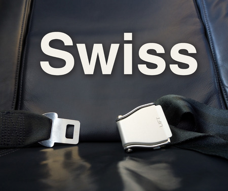 Welcome to Swiss! Lets the journey begin! Airplane comfortable leather seat awaiting passenger for fly, travel, journey, tour, trip, voyage.