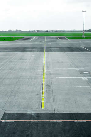 Empty runway tarmac with directional and markings sign, landing lights and services at a international commercial airport Reklamní fotografie