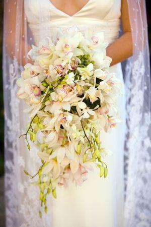 bridal bouquet and lace veil