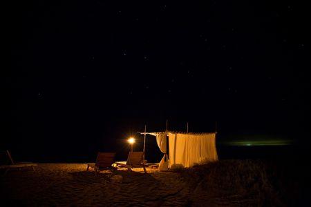 cabana: Beach cabana under the stars on an island.
