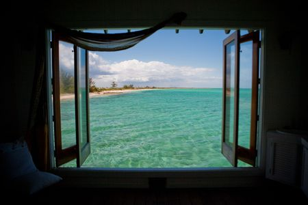 window: Windows opened with a veiw of the Caribbean Sea Stock Photo