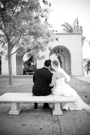 Bride and groom on a bench photo