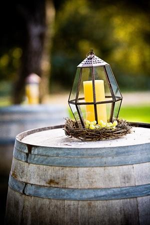Candle on a wood barrel Stock fotó