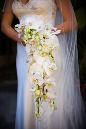 cascade: Bride holding a bouquet Stock Photo