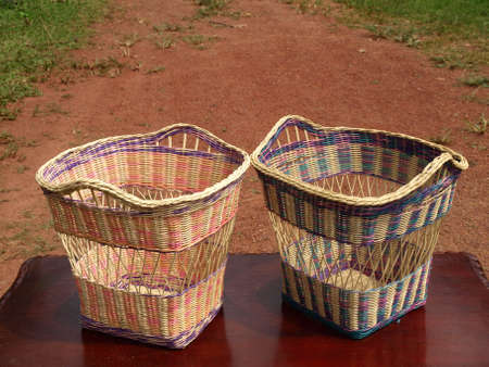 Handmade laundry basket made from rattan. Blurred background
