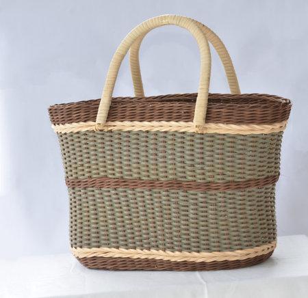 Handmade rattan bag in modern design with handles