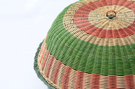 A traditional food cover made from woven rattan, locally known in Malaysia as tudung saji