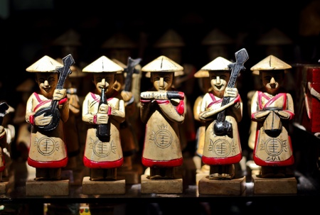 A small band carved of wood plays silently in Vietnam  版權商用圖片
