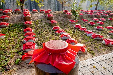 Chinese liquor cellar hidden altar jars Stock Photo