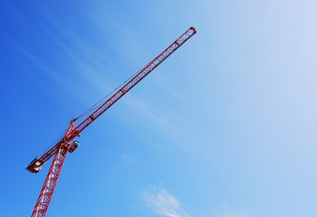 bidding: Red Tower Crane with Wispy Clouds Stock Photo
