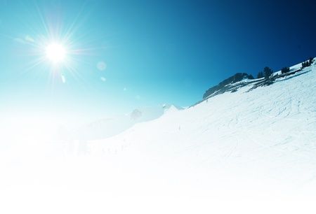 Sunny Slope under Clear Winter Sky photo
