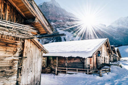old barn in winter: sunset winter cabin in the Karwendel mountains